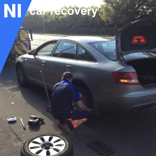 Replacing a flat tyre in Lisburn